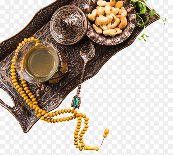 Tea glass with nuts and beads on tray PNG