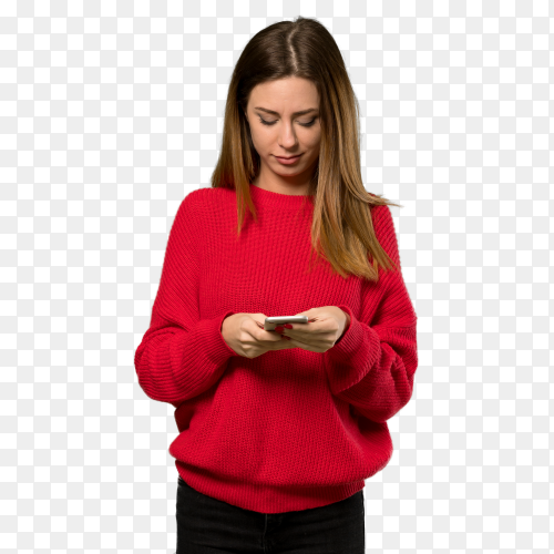 Young woman with red sweater sending message with mobile on transparent background PNG