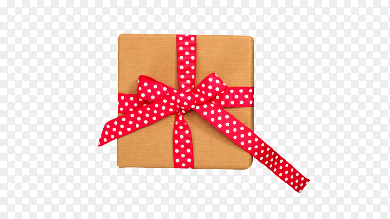 Christmas presents. Beige gift box with red ribbon isolated on transparent background PNG